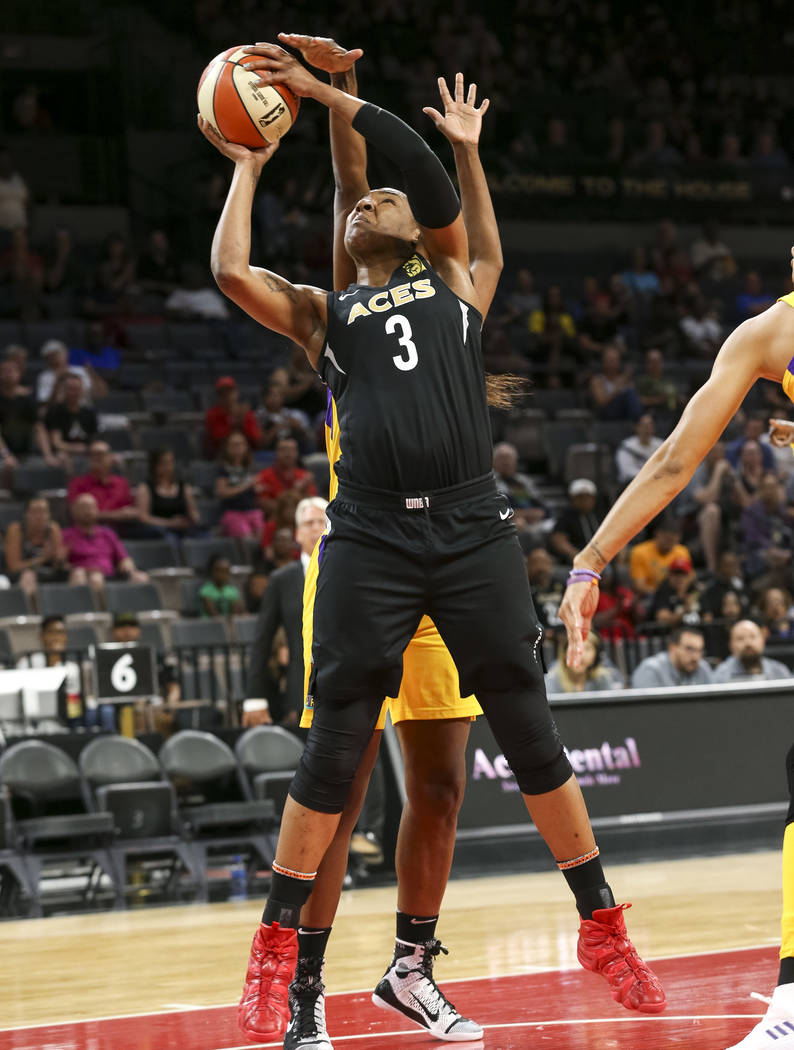 Las Vegas Aces center Kelsey Bone (3) shoots as Los Angeles Sparks center Jantel Lavender (42), background, defends during the first half of a WNBA basketball game at the Mandalay Bay Events Cente ...