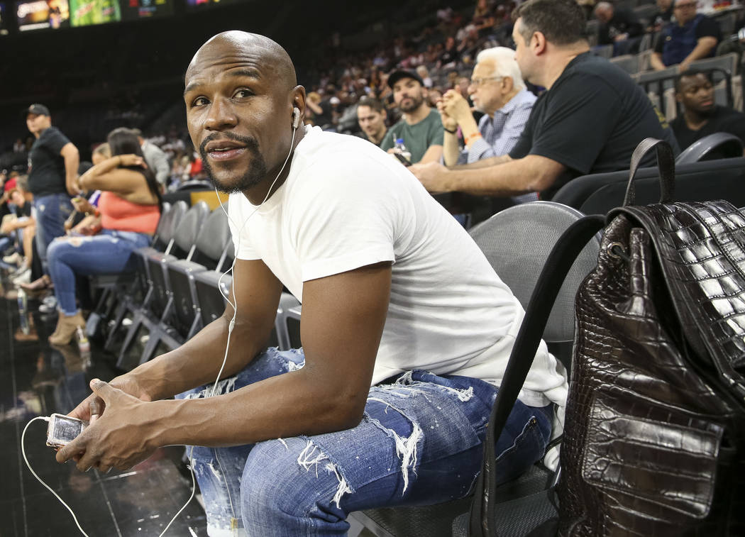 Boxer Floyd Mayweather attends the Las Vegas Aces and Los Angeles Sparks WNBA basketball game at the Mandalay Bay Events Center in Las Vegas on Friday, June 29, 2018. Richard Brian Las Vegas Revie ...