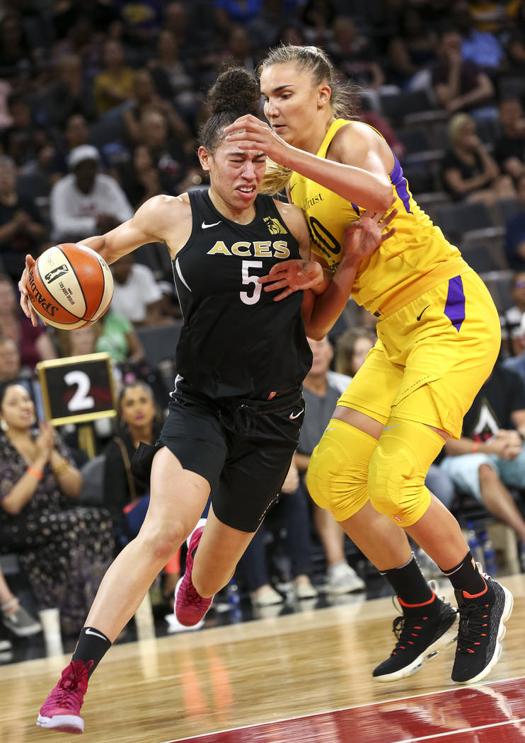 Las Vegas Aces forward Dearica Hamby (5) drives the ball against Los Angeles Sparks center Maria Vadeeva (10) during the second half of a WNBA basketball game at the Mandalay Bay Events Center in ...