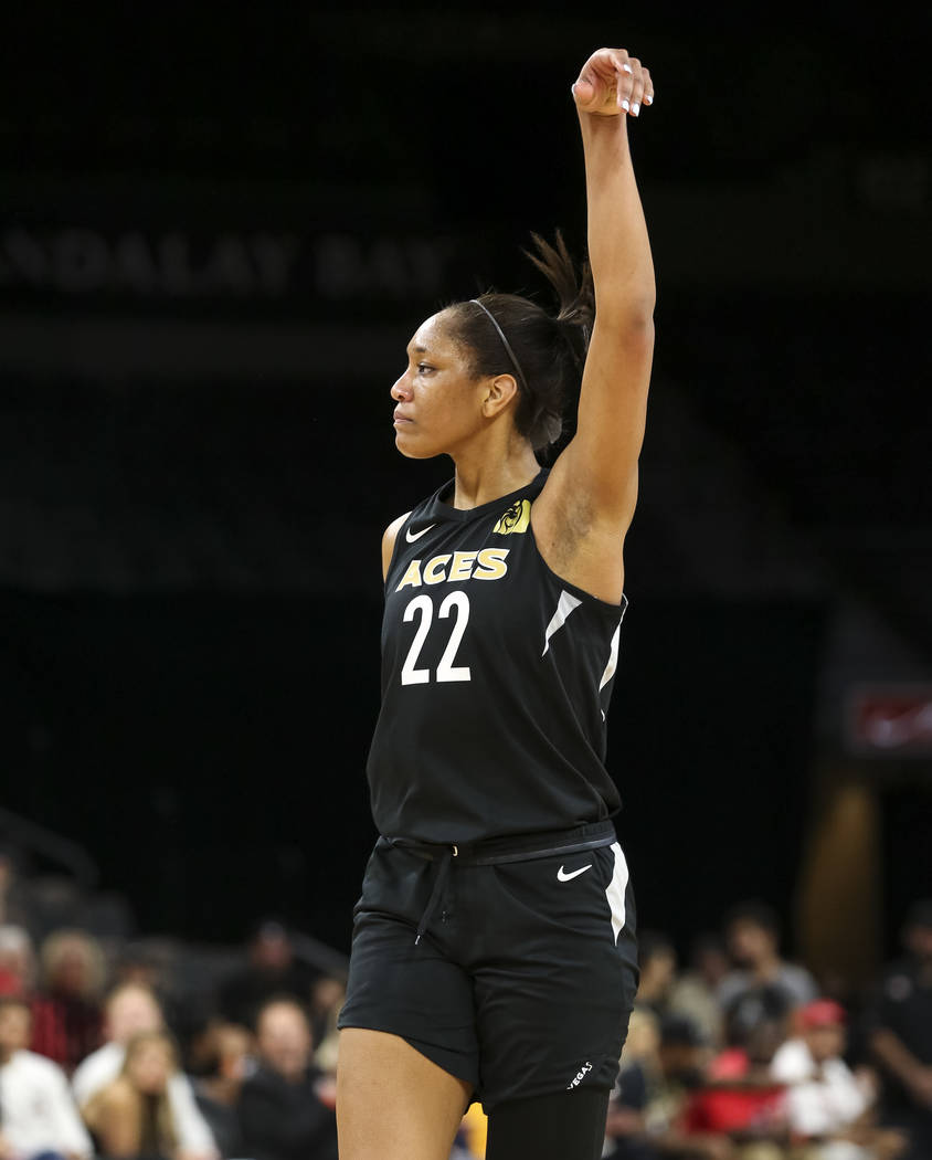 Las Vegas Aces center A'ja Wilson (22) reacts after getting fouled by Los Angeles Sparks forward Candace Parker (3) during the second half of a WNBA basketball game at the Mandalay Bay Events Cent ...