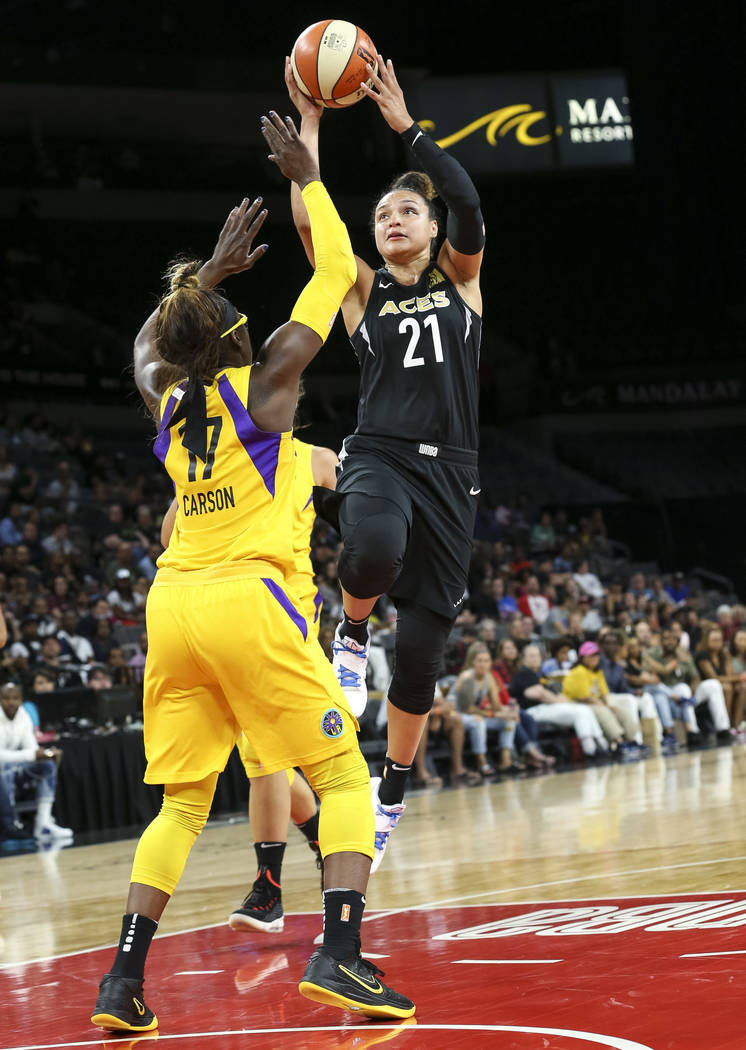 Las Vegas Aces guard Kayla McBride (21) shoots over Los Angeles Sparks forward Essence Carson (17) during the second half of a WNBA basketball game at the Mandalay Bay Events Center in Las Vegas o ...