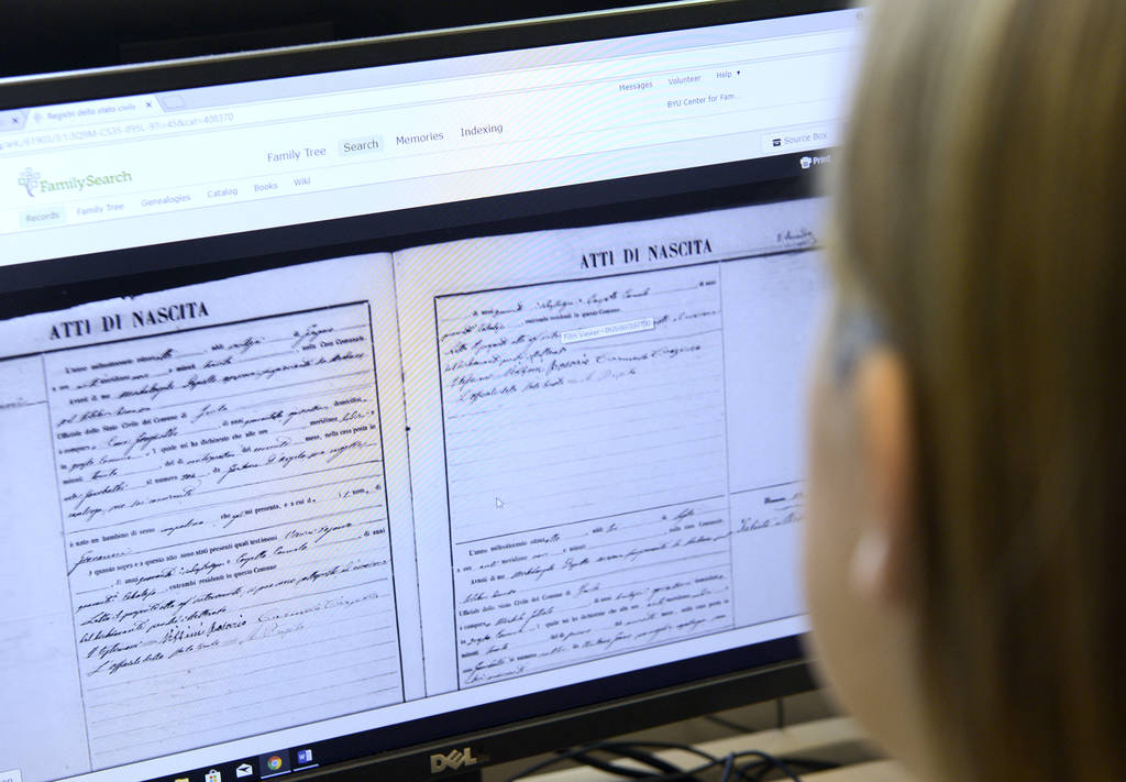 BYU graduate Melanie Torres researches genealogy files at the BYU Center for Family History and Genealogy in Provo, Utah, on June 21. (Leah Hogsten/The Salt Lake Tribune via AP)