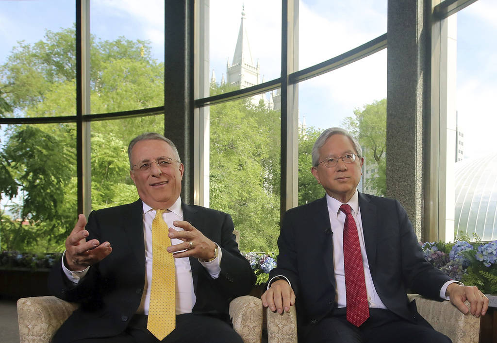 The two newest members of a top Mormon governing panel, Ulisses Soares, left, and Gerrit W. Gong, right, speak on Thursday, June 28, 2018, in Salt Lake City, during their first media interviews si ...
