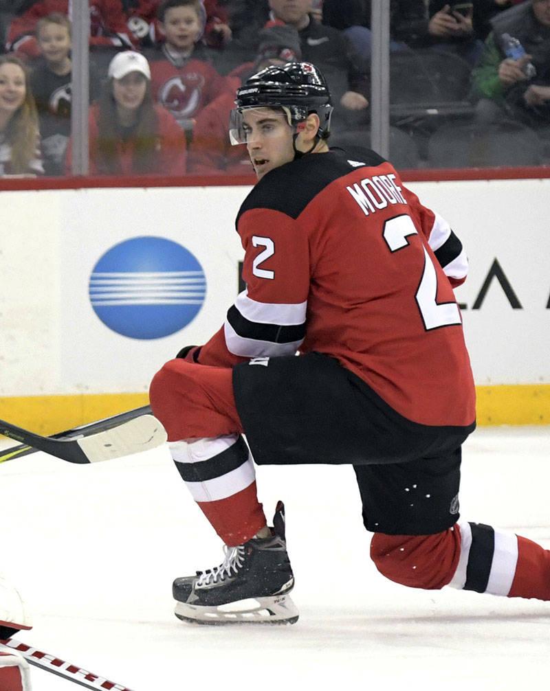New Jersey Devils defenseman John Moore, seen in March 2018. (AP Photo/Bill Kostroun)