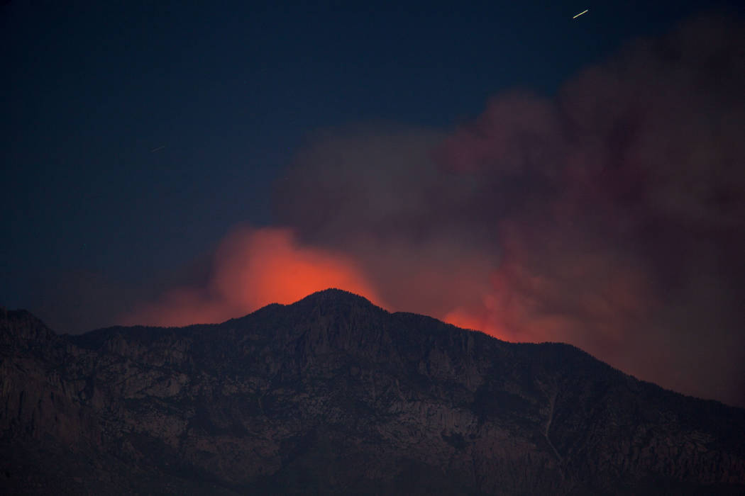 Smoke and glow from a wildfire is seen from Washington City, Utah, Thursday, June 28, 2018. Firefighters were battling more than a half dozen wild land blazes across Utah in record heat and windy ...