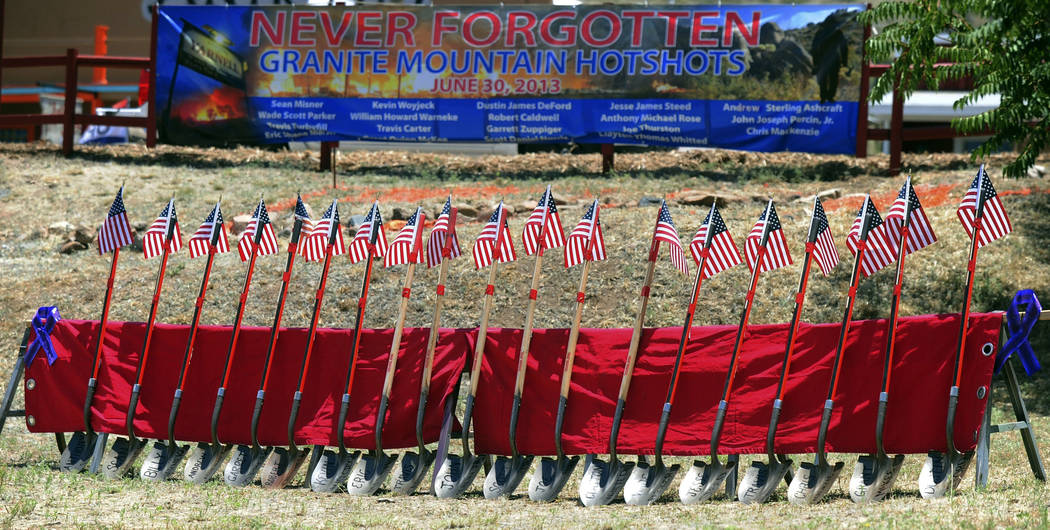 Flag-topped shovels with the names of the Granite Mountain Hotshots on their blades were displayed to mark the second anniversary of their deaths on June 30 in Yarnell Hill Fire in Yarnell, Ariz. ...