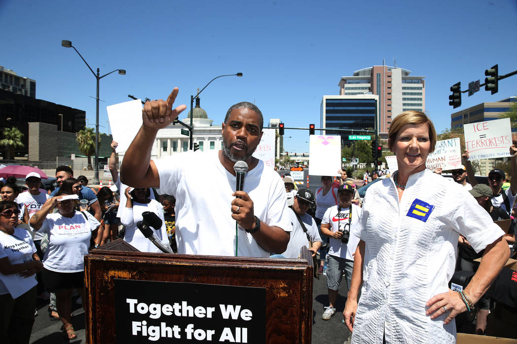 Democratic congressional candidates Steven Horsford, left, and Susie Lee, participate during a rally against the separation of immigrant families outside of the Lloyd George U.S. Courthouse in Las ...