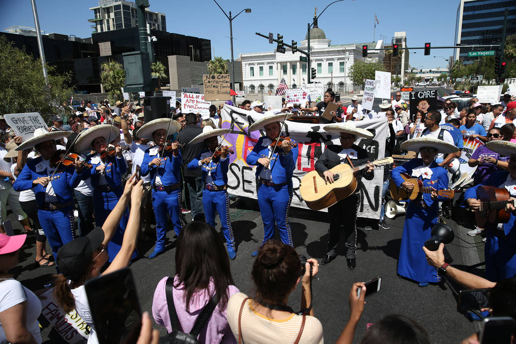 A mariachi plays music during a rally against the separation of immigrant families outside of the Lloyd George U.S. Courthouse in Las Vegas, Saturday, June 30, 2018. Erik Verduzco Las Vegas Review ...