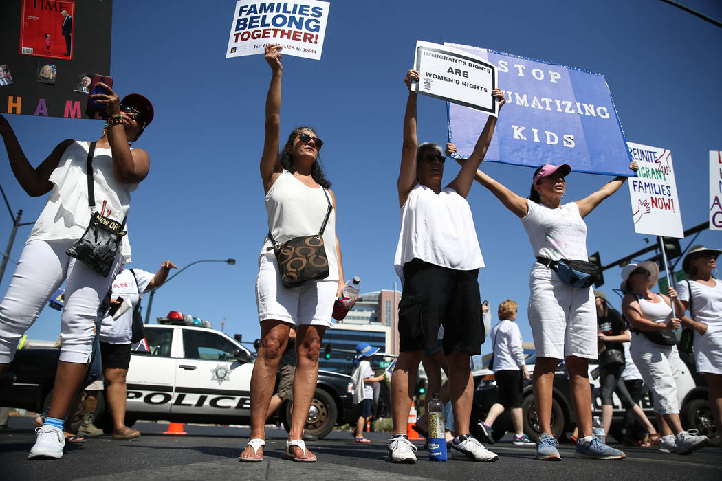 Karen Wade, from left, Hilda Ambarsoom, her sister Hasmik, and Sylvia Vazquez, participate during a rally against the separation of immigrant families outside of the Lloyd George U.S. Courthouse i ...