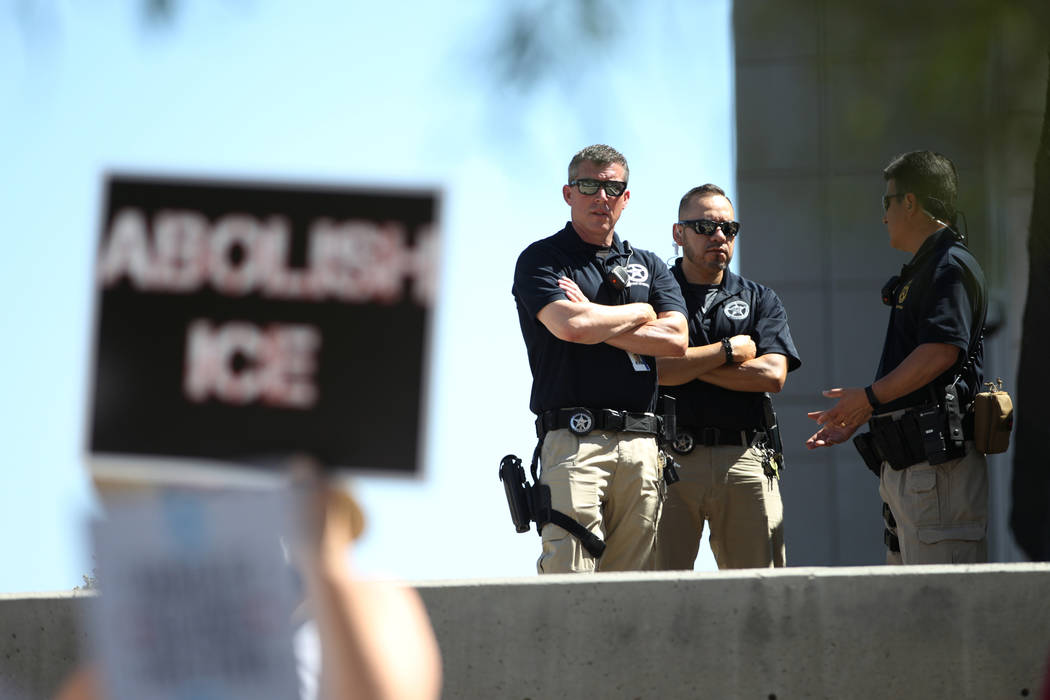 Officers keep an eye during a rally against the separation of immigrant families outside of the Lloyd George U.S. Courthouse in Las Vegas, Saturday, June 30, 2018. Erik Verduzco Las Vegas Review-J ...