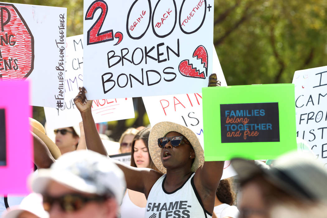 Veronica Joseph of Las Vegas, center, participates during a rally against the separation of immigrant families outside of the Lloyd George U.S. Courthouse in Las Vegas, Saturday, June 30, 2018. Er ...