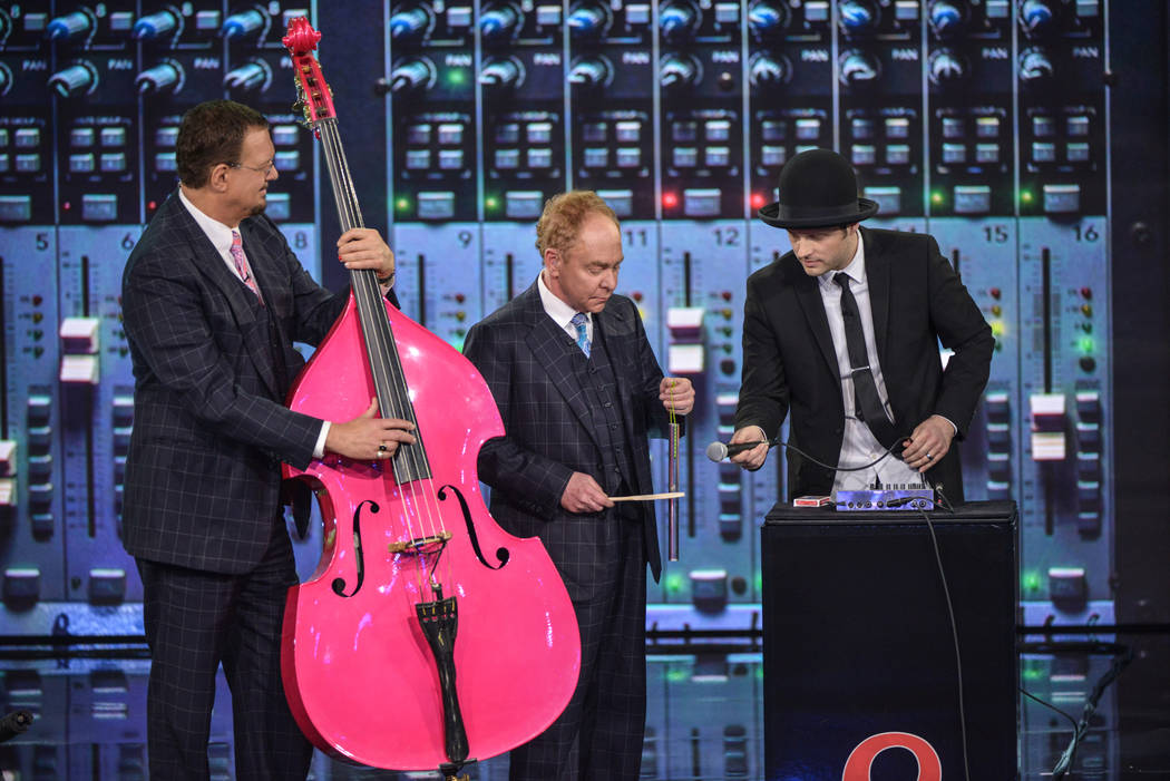 "Penn & Teller perform during the ""Penn & Teller Get Loopy"" episode on The CW's ""Penn & Teller: Fool Us"" show (The CW)"