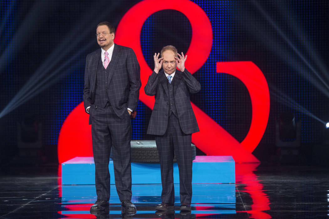 "Penn & Teller perform during the ""Penn & Teller April Fool Us Day"" episode on The CW's ""Penn & Teller: Fool Us"" show (The CW)"