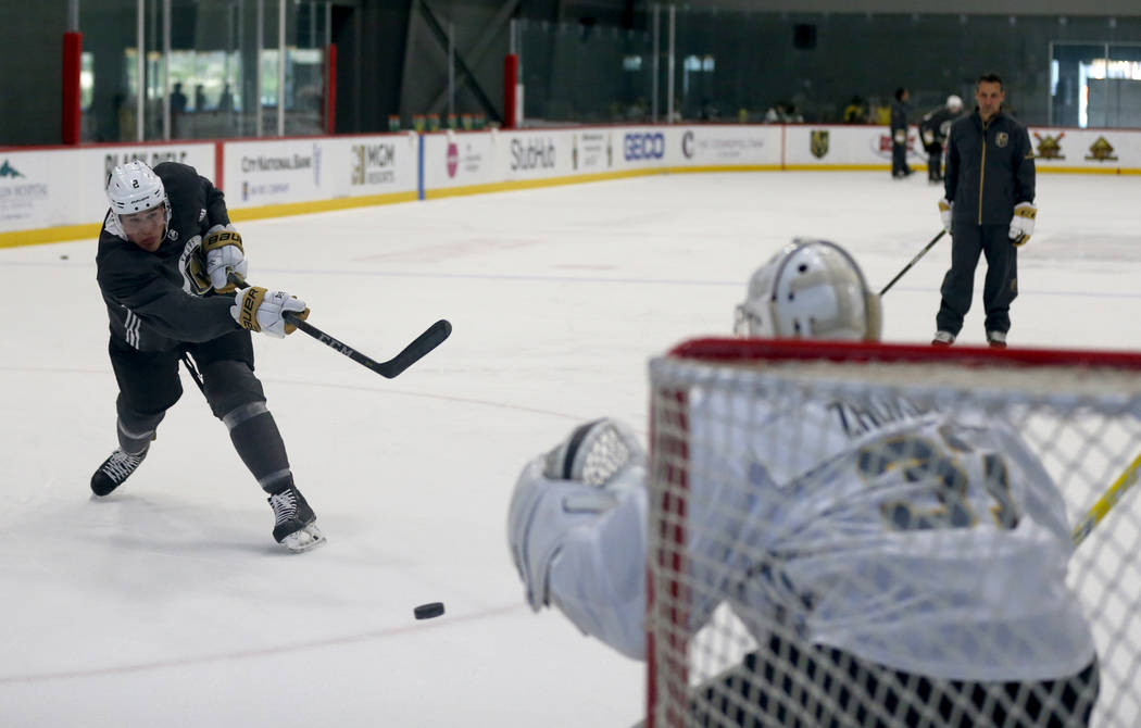 Vegas Golden Knights defender Zach Whitecloud shoots on goaltender Maksim Zhukov during the first day of development camp at City National Arena in Las Vegas Tuesday, June 26, 2018. K.M. Cannon La ...