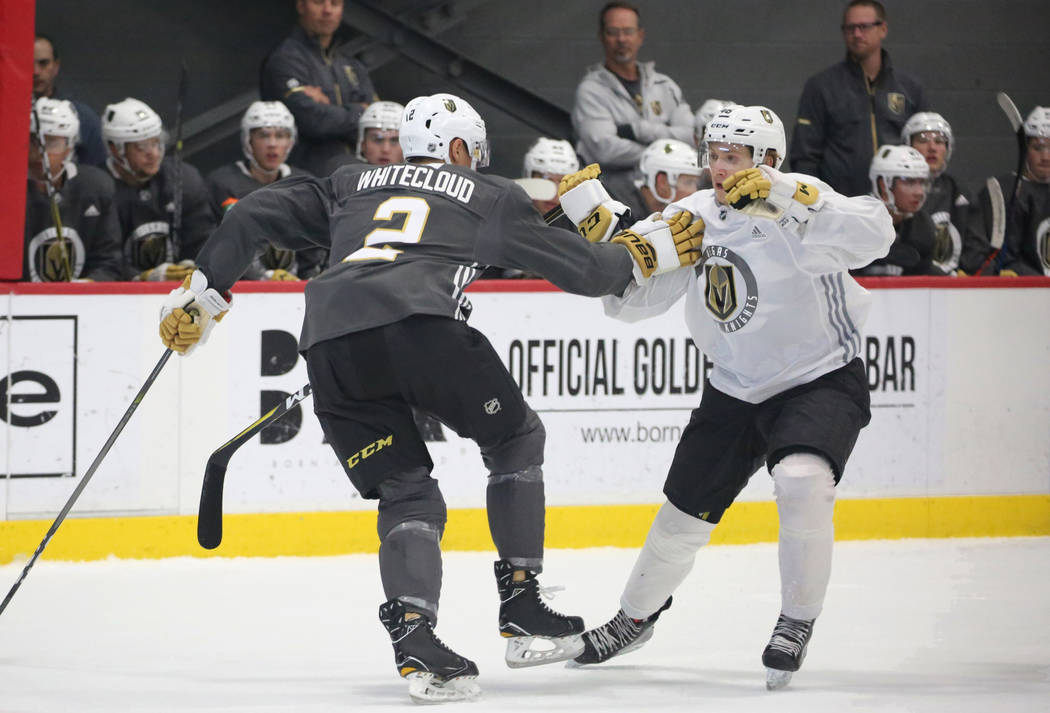 Vegas Golden Knights prospect Zach Whitecloud (2) defends Jonas Rondbejerg during scrimmage at Golden Knights development camp at City Center Arena on Friday, June 29, 2018, in Las Vegas. Bizuayeh ...
