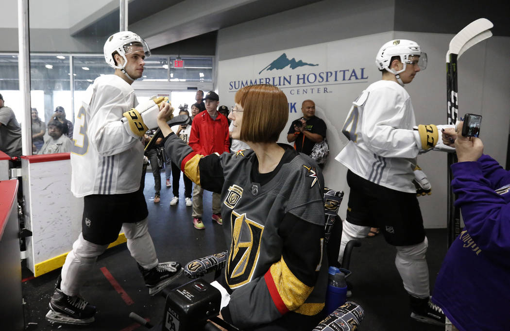 Vegas Golden Knights prospect Gage Quinney makes a fist bump Shannon Walker of Las Vegas after scrimmage at Golden Knights development camp at City Center Arena on Friday, June 29, 2018, in Las Ve ...