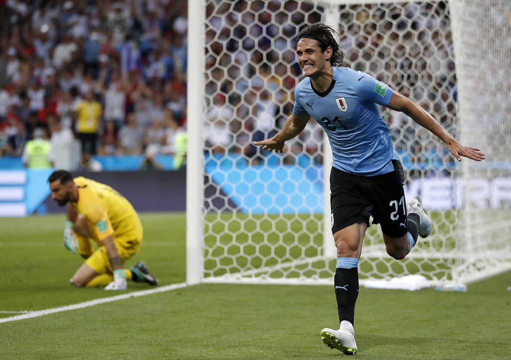 Uruguay's Edinson Cavani celebrates after he scored the opening goal during the round of 16 match between Uruguay and Portugal at the 2018 soccer World Cup at the Fisht Stadium in Sochi, Russia, S ...