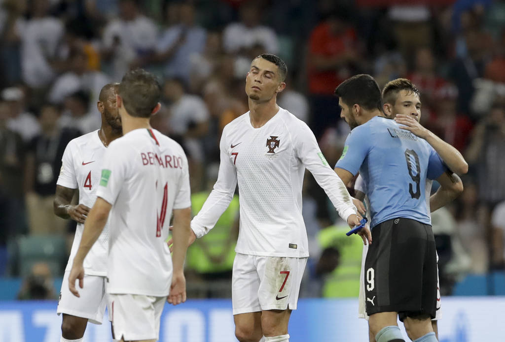 Portugal's Cristiano Ronaldo, center, reacts after the round of 16 match between Uruguay and Portugal at the 2018 soccer World Cup at the Fisht Stadium in Sochi, Russia, Saturday, June 30, 2018. ( ...