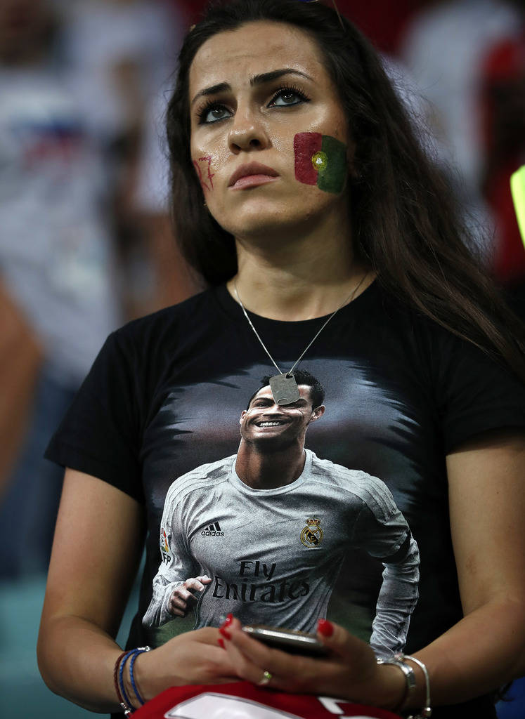 A fan of Portugal's Cristiano Ronaldo watches sad after the round of 16 match between Uruguay and Portugal at the 2018 soccer World Cup at the Fisht Stadium in Sochi, Russia, Saturday, June 30, 20 ...