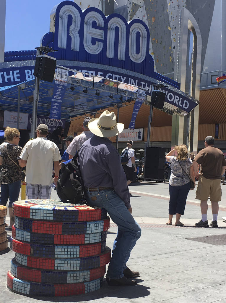 Visitors to the BBQ, Brews and Blues festival listen to a band in downtown Reno on June 16, 2018. The number of tourists visiting Reno-Sparks and Washoe County over the past year topped the 5 mill ...