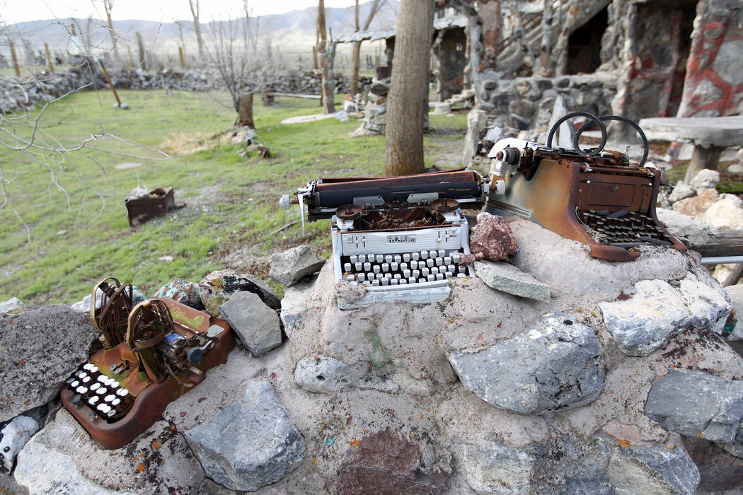 Typewriters and other found items are incorporated into a fence near the main structure and living quarters at Nevada historical site Thunder Mountain Monument near Imlay Tuesday, April 10, 2018. ...