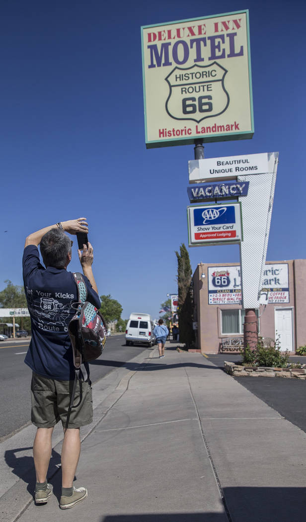 Tourists take photos of the signage at the Deluxe Inn Motel on Wednesday, May 16, 2018, in Seligman, AZ. Benjamin Hager Las Vegas Review-Journal @benjaminhphoto