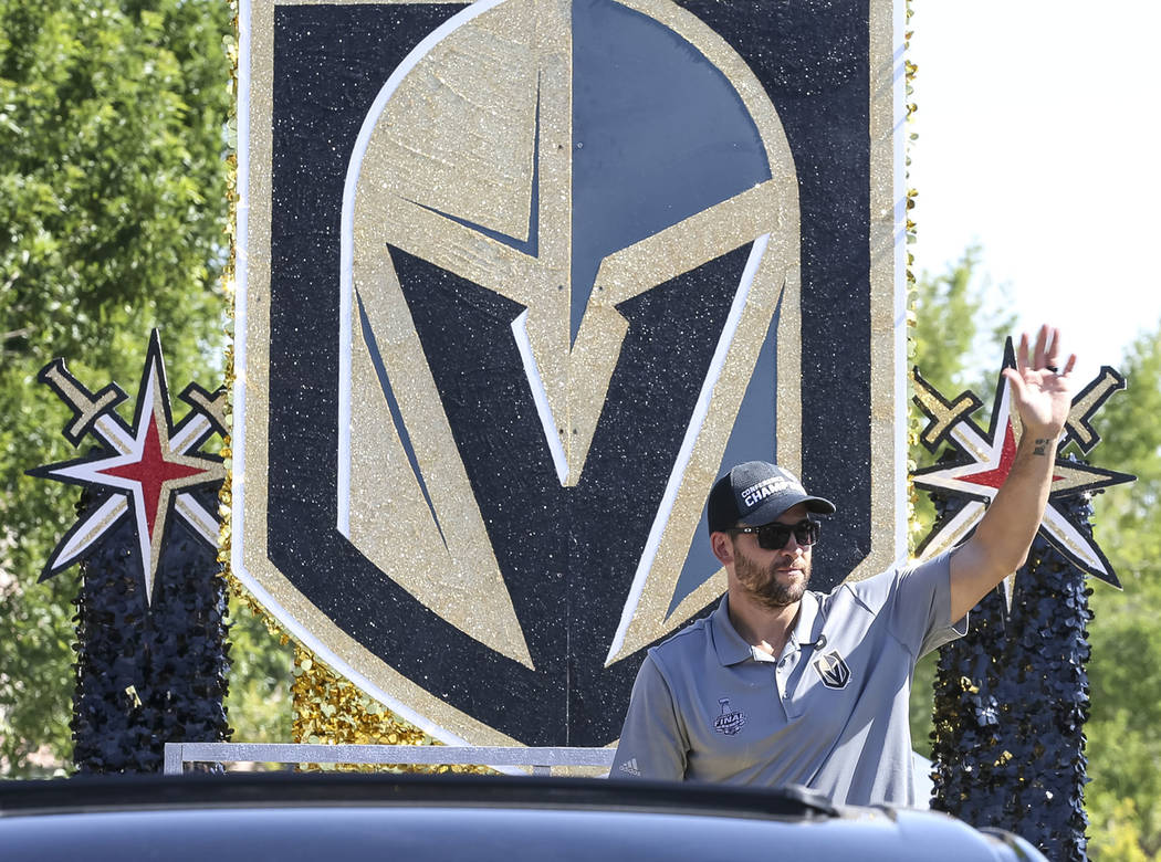 Vegas Golden Knights defenseman Deryk Engelland waves to cheering fans from the City National Bank and Vegas Golden Knights float during the Summerlin Council Patriotic Parade in Las Vegas on Wedn ...