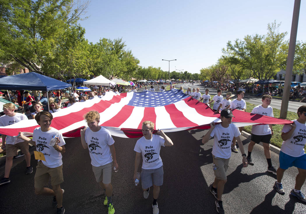 Members of the Palo Verde High School track team march with a giant American Flag during the Summerlin Council Patriotic Parade in Las Vegas on Wednesday, July 4, 2018. Richard Brian Las Vegas Rev ...