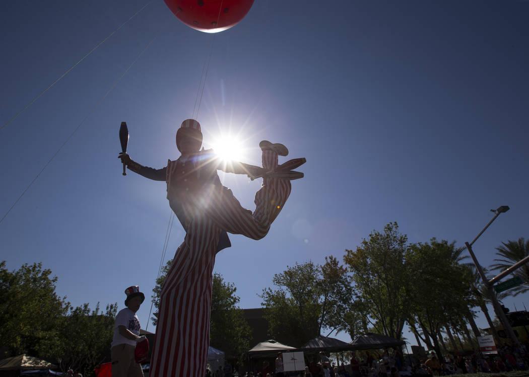 "A stilt walker participates behind Summerlin's ""Happy Birthday, America"" float during the Summerlin Council Patriotic Parade in Las Vegas on Wednesday, July 4, 2018. Richard Brian Las Ve ..."