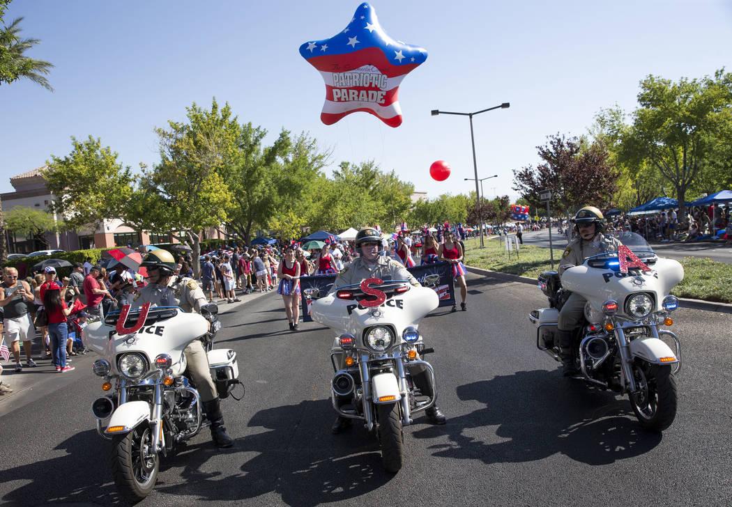 Members of the Las Vegas Metropolitan Police Department traffic bureau lead the start of the Summerlin Council Patriotic Parade in Las Vegas on Wednesday, July 4, 2018. Richard Brian Las Vegas Rev ...