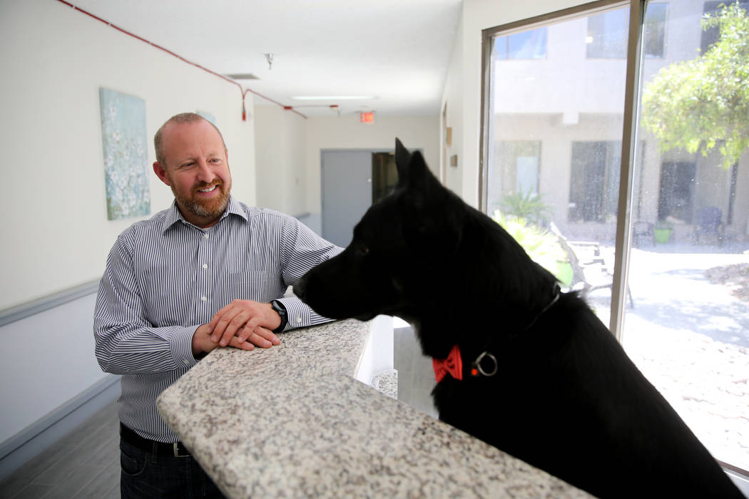 Co-founder Jeffrey Iverson with Dude the German shepherd at CrossRoads of Southern Nevada psychiatric urgent care facility at 2121 W. Charleston Blvd. in Las Vegas Wednesday, June 6, 2018. Dude is ...