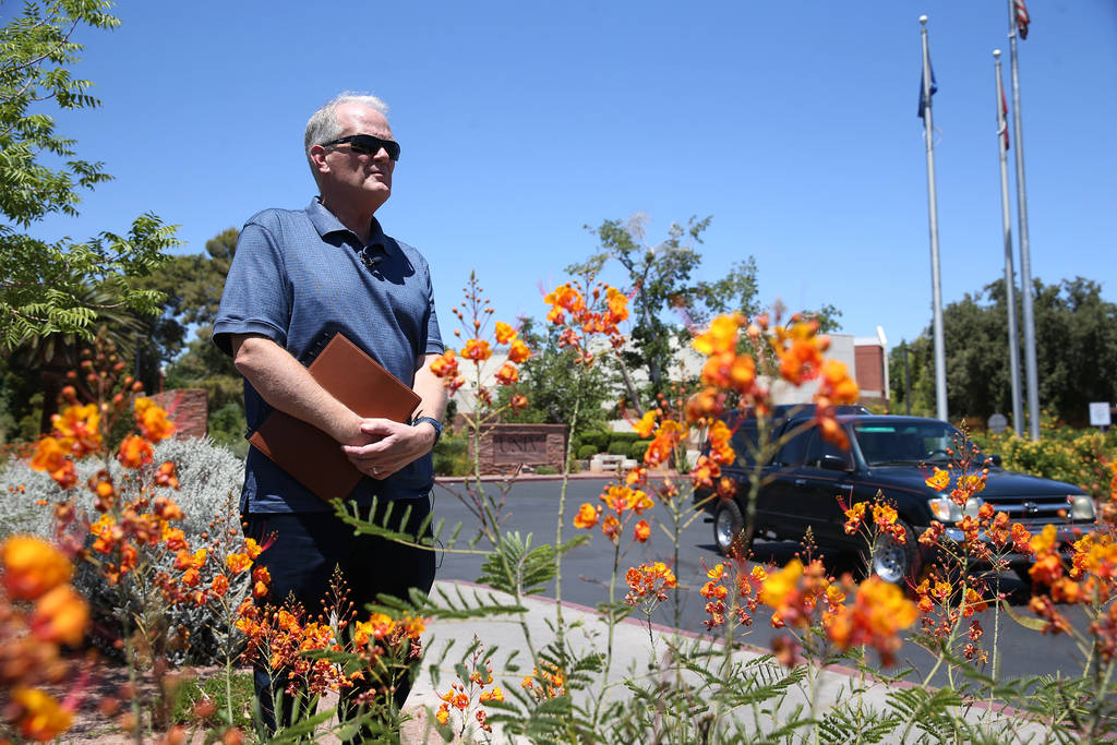 Timothy Bungum, UNLV professor in the School of Community Health Sciences department, observes the intersection of Maryland Parkway and Harmon Avenue in Las Vegas, Wednesday, June 27, 2018. A stud ...