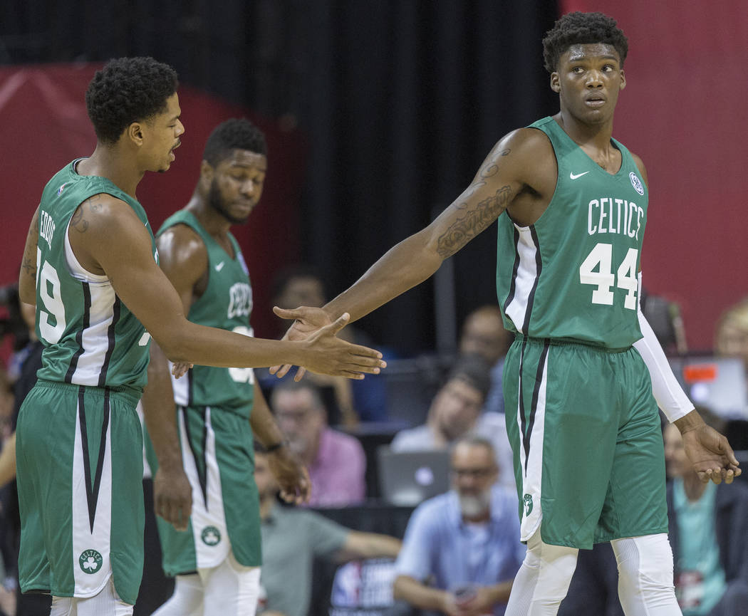 Celtics center Robert Williams (44) celebrates with forward Jarell Eddie (39) during Boston's game with the Philadelphia 76ers during NBA Summer League on Friday, July 6, 2018, at the Thomas & ...