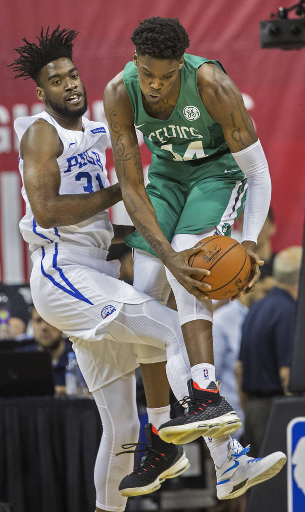 Boston Celtics center Robert Williams (44) grabs a rebound over Philadelphia 76ers center Norvel Pelle (31) during NBA Summer League on Friday, July 6, 2018, at the Thomas & Mack Center, in La ...