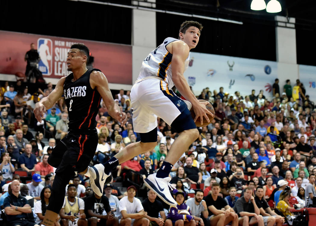 Utah Jazz guard Grayson Allen, right, lays the ball up against Portland Trail Blazer guard Wade Baldwin IV during an NBA summer league basketball game Saturday, July 7, 2018, in Las Vegas. David B ...
