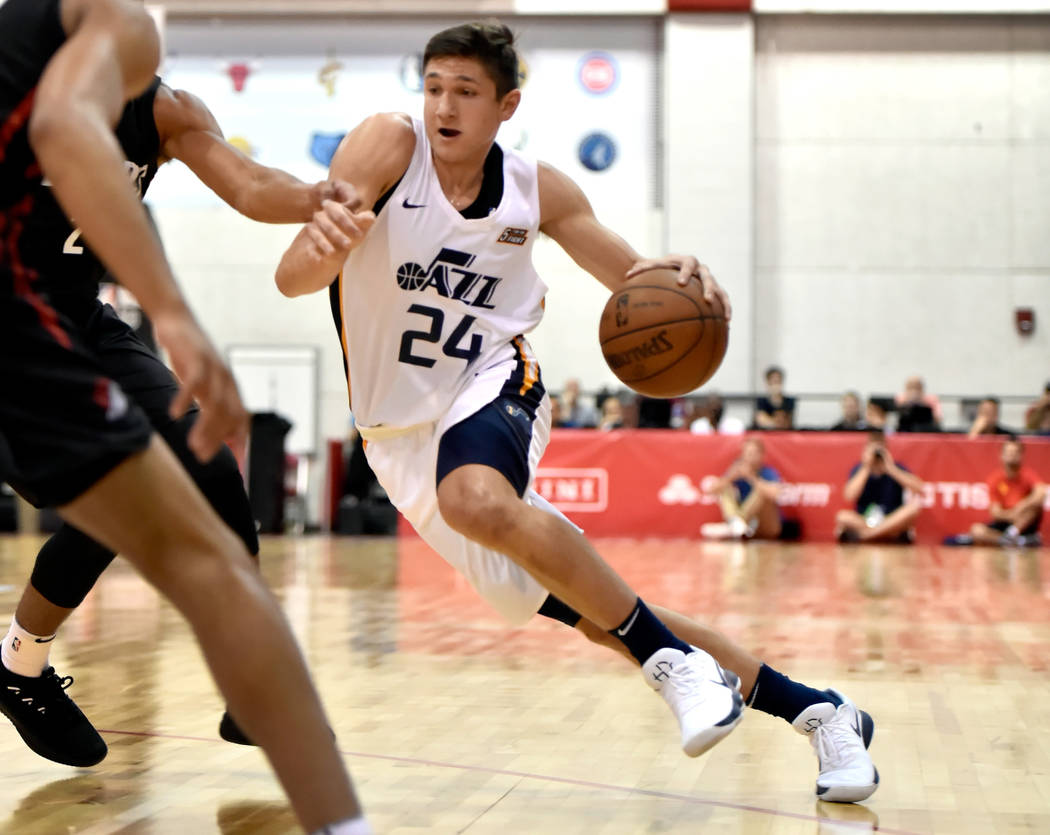 Utah Jazz guard Grayson Allen drives the ball up against the Portland Trail Blazer during an NBA summer league basketball game Saturday, July 7, 2018, in Las Vegas. David Becker/Las Vegas Review-J ...
