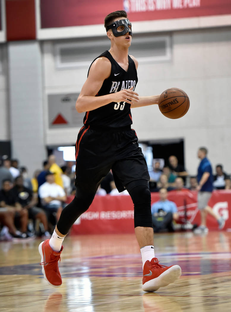 Portland Trail Blazer center Zach Collins dribble the ball during an NBA summer league basketball game against the Utah Jazz Saturday, July 7, 2018, in Las Vegas. David Becker/Las Vegas Review-Jou ...