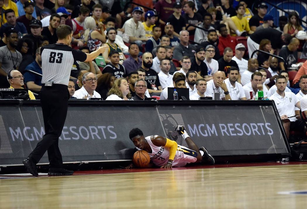 Indian Pacer guard Aaron Holiday slides into the scorer's table during an NBA summer league basketball game against the San Antonio Spurs Saturday, July 7, 2018, in Las Vegas. David Becker/Las Veg ...
