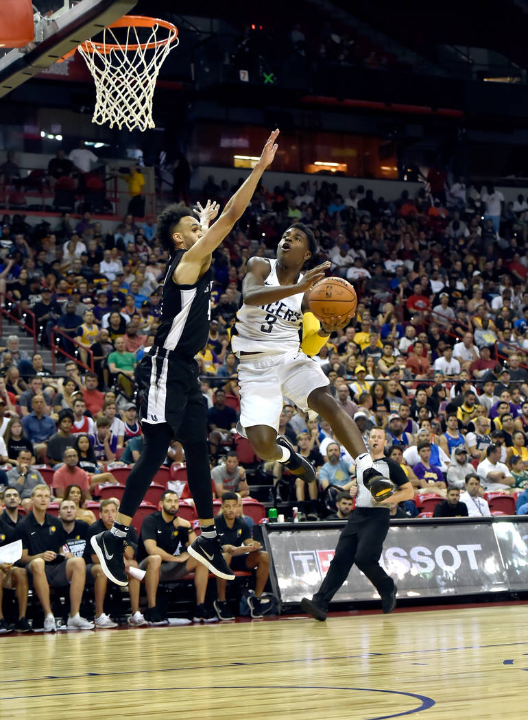 Indian Pacer guard Aaron Holiday (3) shoots against against San Antonio Spurs guard Derrick White during an NBA summer league basketball game Saturday, July 7, 2018, in Las Vegas. David Becker/Las ...