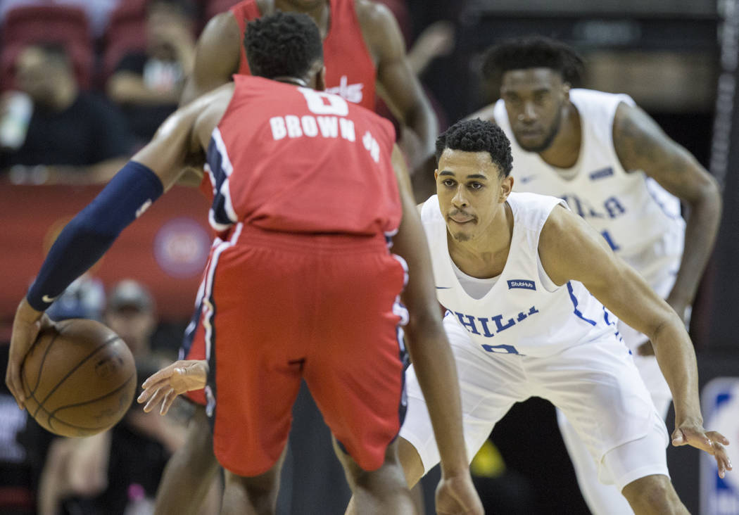 Philadelphia 76ers guard Zhaire Smith (8) defends Washington Wizards guard Troy Brown, Jr. (6) during the NBA Summer League on Monday, July 9, 2018, at the Thomas & Mack Center, in Las Vegas. ...