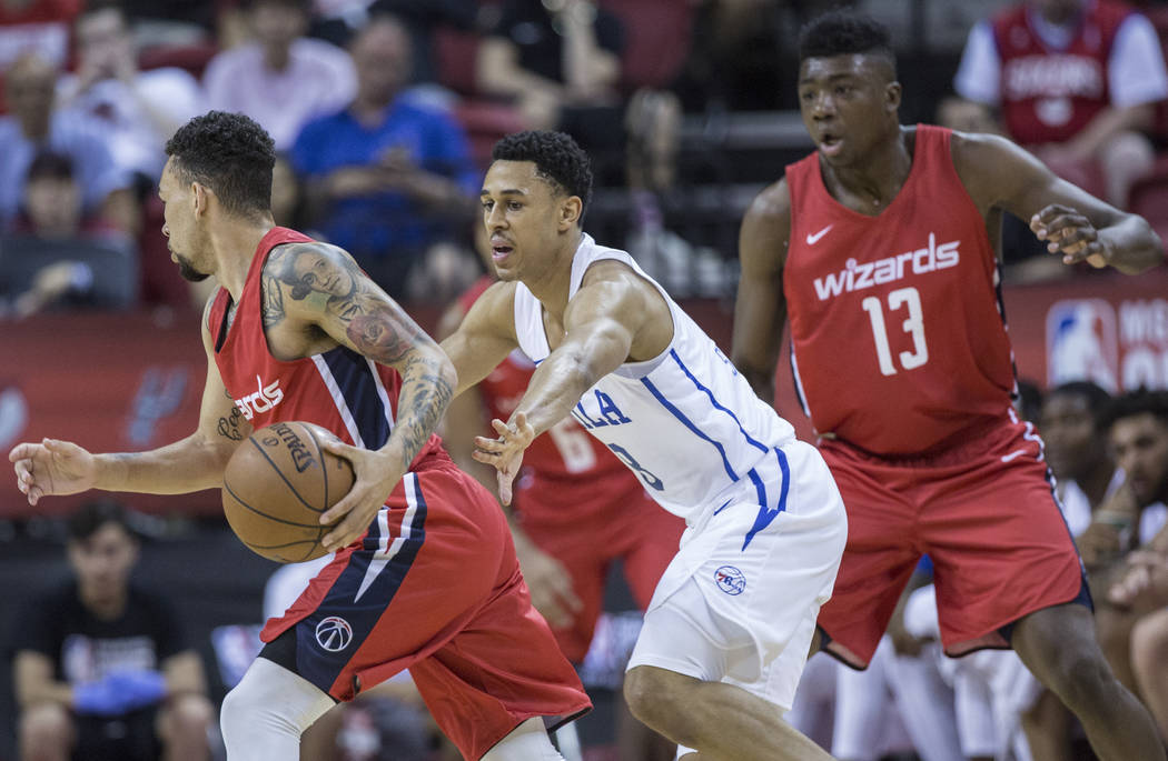 Philadelphia 76ers guard Zhaire Smith (8) defends Washington Wizards guard Chris Chiozza (33) during the NBA Summer League on Monday, July 9, 2018, at the Thomas & Mack Center, in Las Vegas. B ...