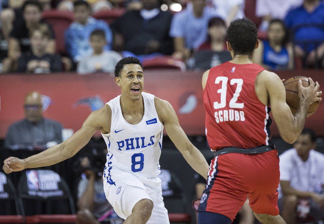 Philadelphia 76ers guard Zhaire Smith (8) defends Washington Wizards guard Philip Scrubb (32) during the NBA Summer League on Monday, July 9, 2018, at the Thomas & Mack Center, in Las Vegas. B ...