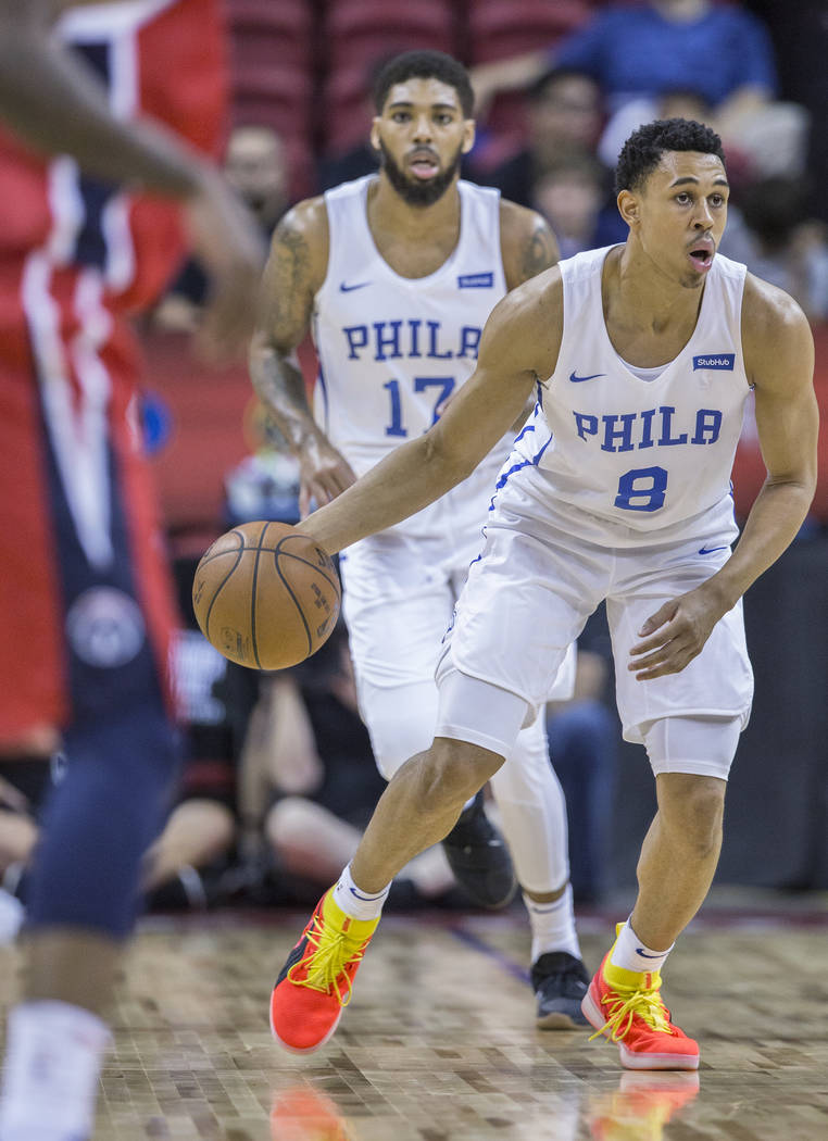 76ers guard Zhaire Smith (8) pushes the ball up court during Philadelphia's NBA Summer League game with the Washington Wizards on Monday, July 9, 2018, at the Thomas & Mack Center, in Las Vega ...