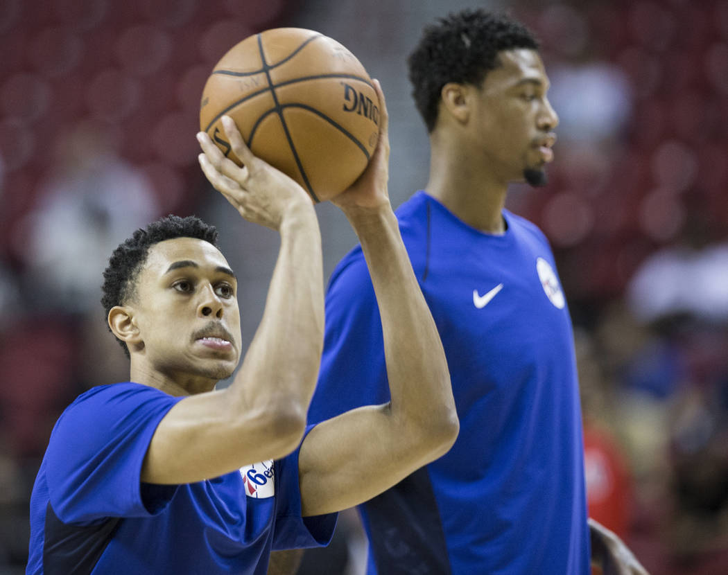 76ers guard Zhaire Smith (8) warms up before the start of Philadelphia's NBA Summer League game with the Washington Wizards on Monday, July 9, 2018, at the Thomas & Mack Center, in Las Vegas. ...