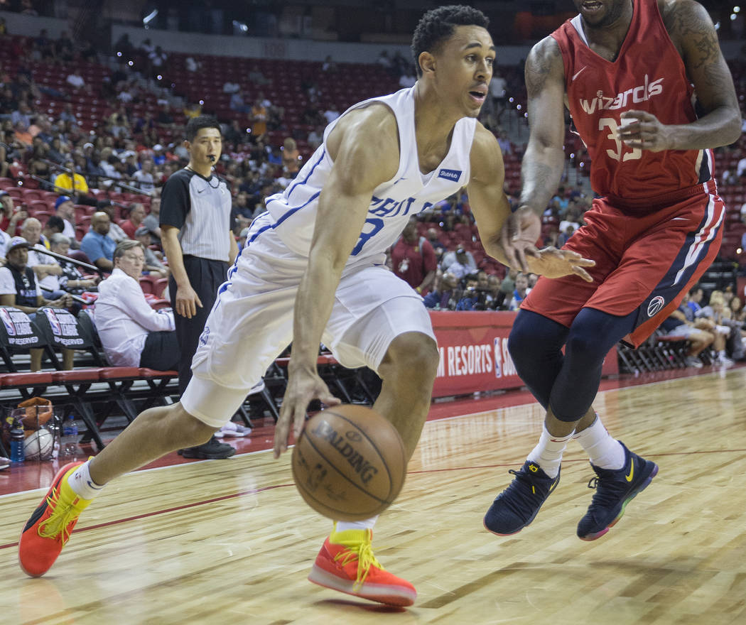 Philadelphia 76ers guard Zhaire Smith (8) drives baseline past Washington Wizards Tiwian Kendley guard (35) during the NBA Summer League on Monday, July 9, 2018, at the Thomas & Mack Center, i ...