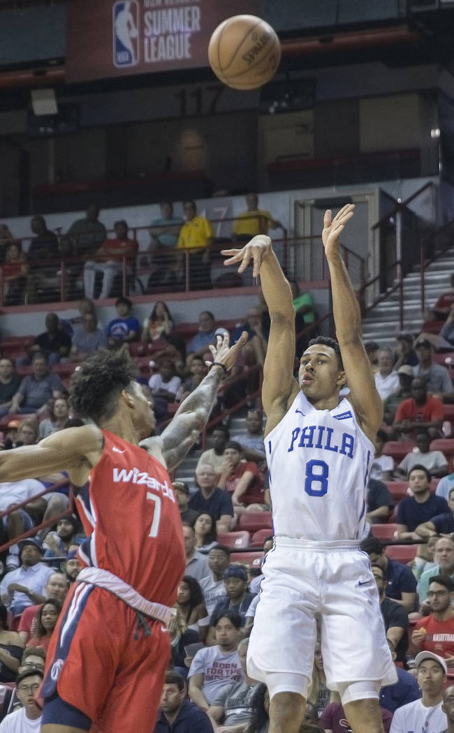 Philadelphia 76ers guard Zhaire Smith (8) shoots a corner jump shot over Washington Wizards forward Devin Robinson (7) during the NBA Summer League on Monday, July 9, 2018, at the Thomas & Ma ...