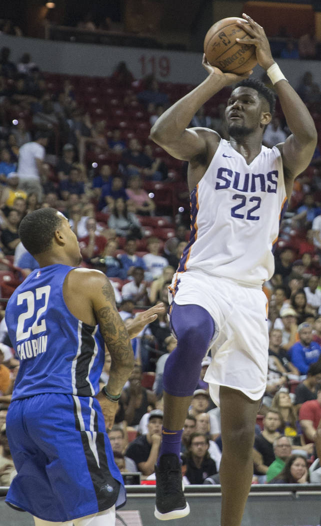 Phoenix Suns center Deandre Ayton (22) shoots over Orlando Magic guard Troy Caupain (22) in the second quarter during the NBA Summer League on Monday, July 9, 2018, at the Thomas & Mack Center ...