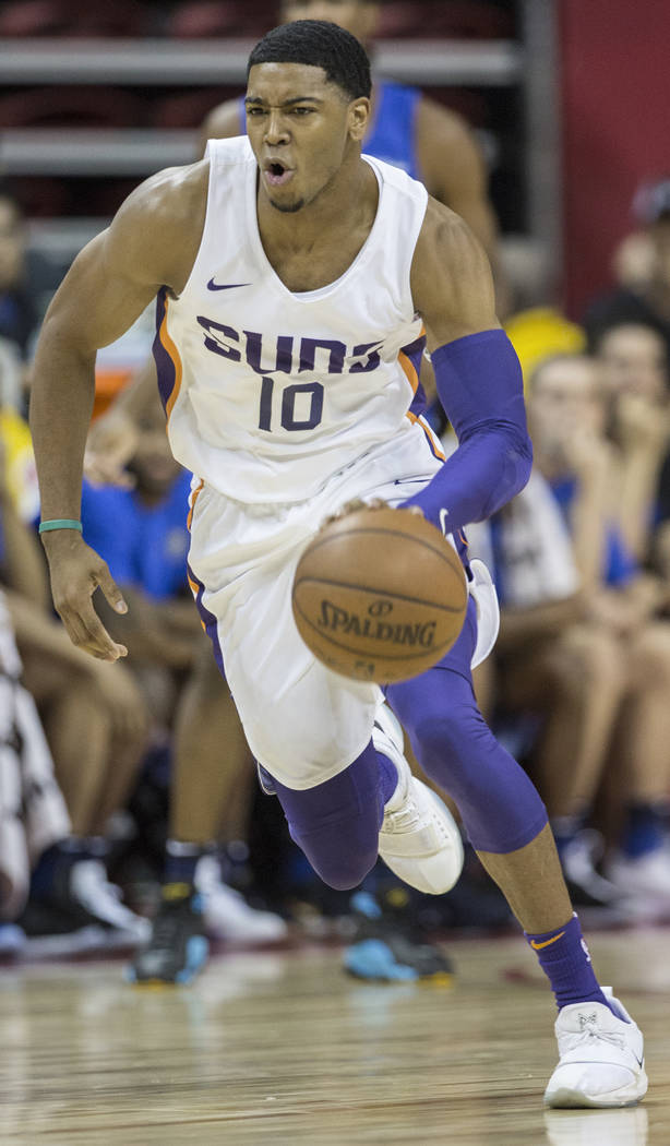 Suns guard Shaquille Harrison (10) pushes the ball up court in the first quarter during Phoenix's NBA Summer League game with the Orlando Magic on Monday, July 9, 2018, at the Thomas & Mack Ce ...
