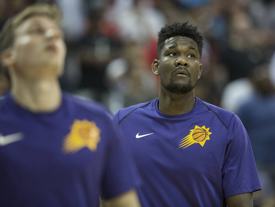Suns center Deandre Ayton (22) warms up before the start of Phoenix's NBA Summer League game with the Orlando Magic on Monday, July 9, 2018, at the Thomas & Mack Center, in Las Vegas. Benjamin ...