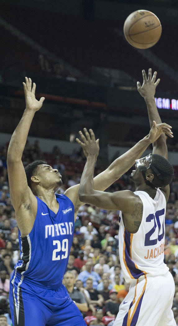 Phoenix Suns forward Josh Jackson (20) shoots over Orlando Magic forward Antonio Campbell (29) in the second quarter during the NBA Summer League on Monday, July 9, 2018, at the Thomas & Mack ...